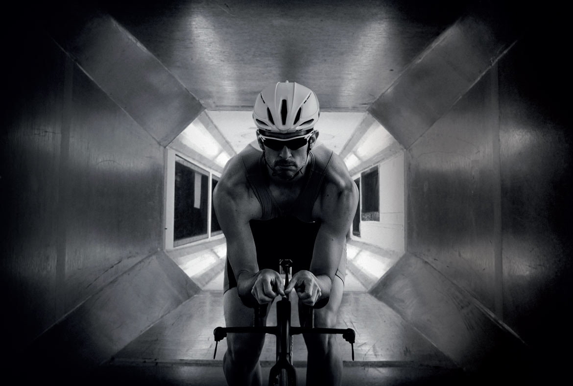 a man is testing the aerodynamic in the wind tunnel
