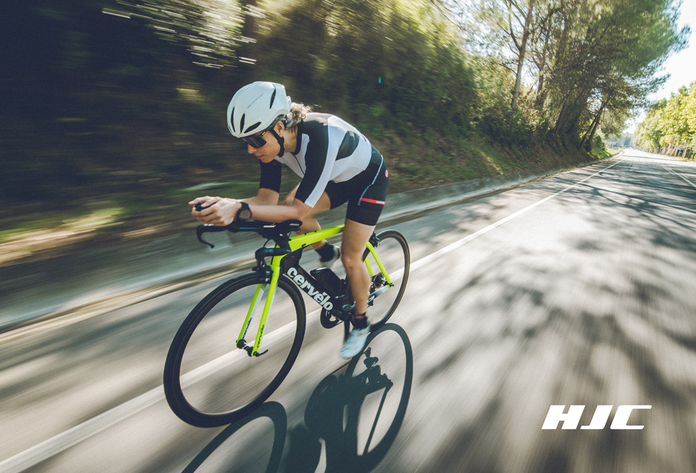 A woman cycling with the HJC Furion 2.0