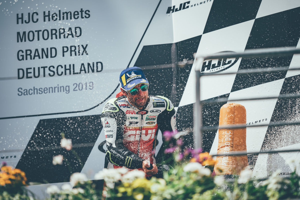 Cal Crutchlow celebrating his place on the podium in Sachsenring